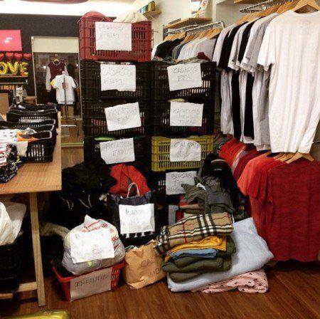 Dono de loja se vinga de assalto doando 400 roupas para morador
