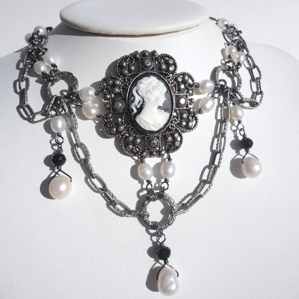 Gothic Cameo Choker in White and Black: Gothic Choker Necklace with White Freshwater Pearls, Black Crystals, and Gunmetal Wire. $39.00, via Etsy.