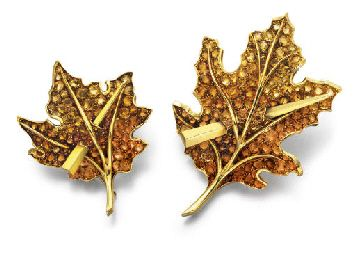 A PAIR OF RETRO CITRINE AND GOLD BROOCHES, BY PAUL FLATO   Each designed as a fall leaf, set with circular-cut yellow, brown and orange citrines, with polished gold veining and stem, pierced by a gold spear, mounted in gold, circa 1940  By Paul Flato (2)