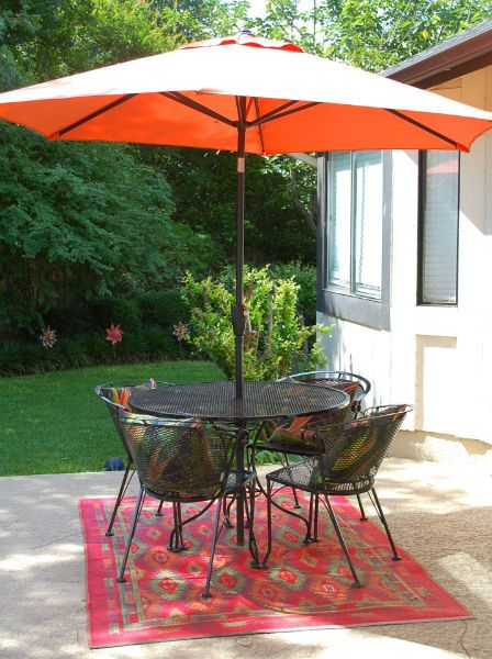 An Umbrella A Coordinating Outdoor Rug And Pretty Pillows Make Your Table As Stylish Indoor One Tuesdaymorning