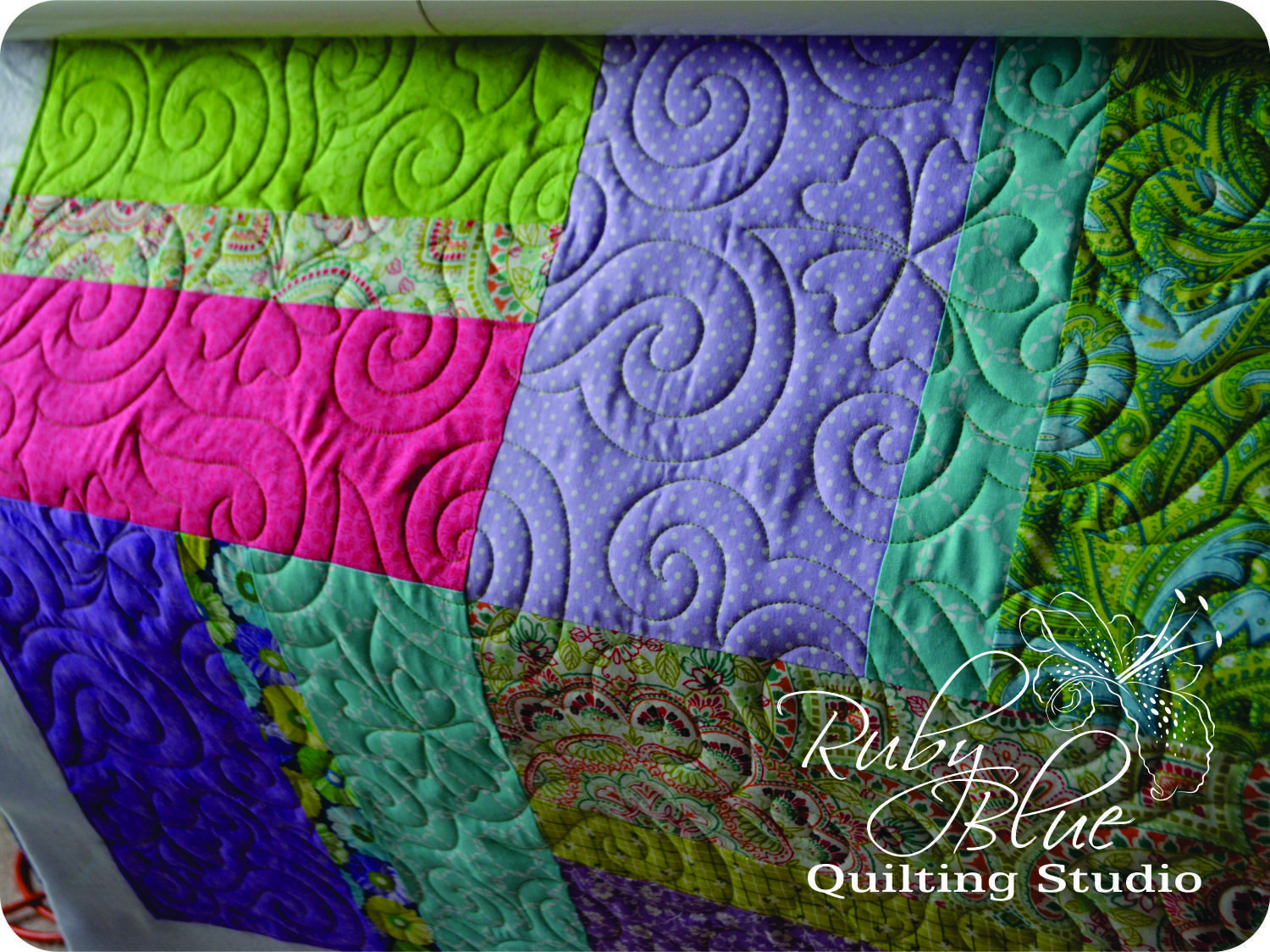 Mary made this quilt and brought it to me to finish for her granddaughter.    Mary wanted flowers and something flowy quilted on this one a...