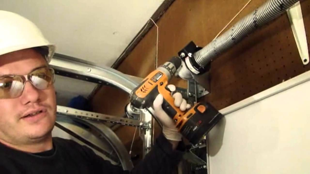 How To Adjust The Spring Tension On A Roll Up Garage Door
