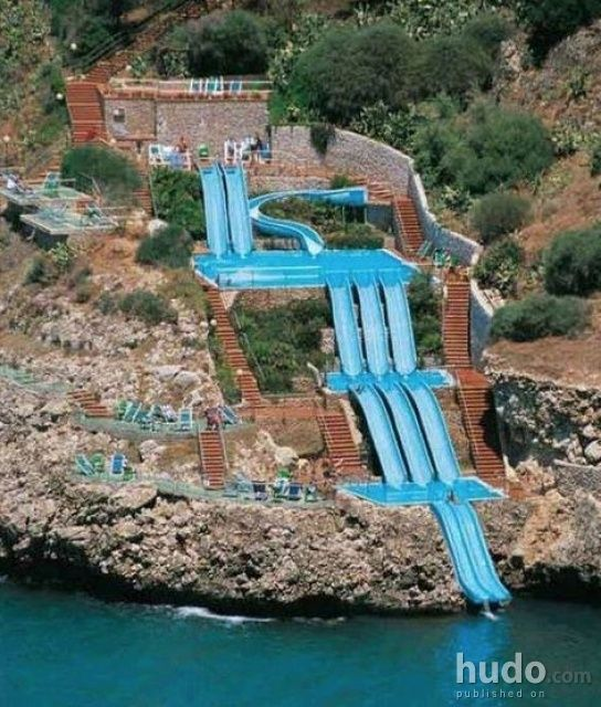 how cool is that swimming poold connected with water slides