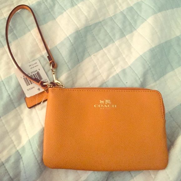 Coach wristlet Brand new orange coach wristlet. Never used it was a Christmas gift but I never liked it. Coach Bags Clutches & Wristlets