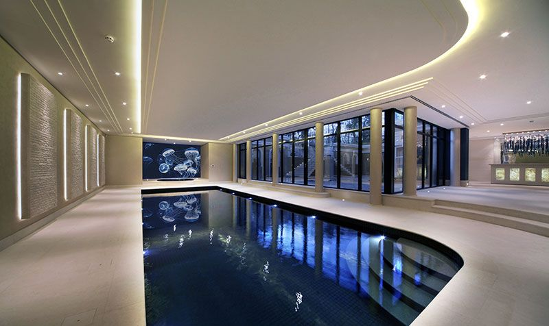 Beautiful indoor pool by falcon pools dark tiles and 12 for Domestic swimming pool design