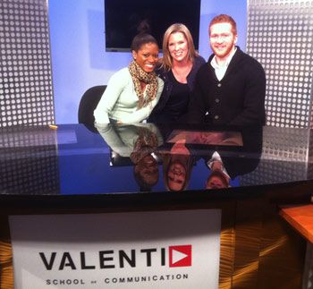 KTRK's Casey Curry in the UH Valenti School's new TV studios with students Allison Monroe and J.C. Gage.