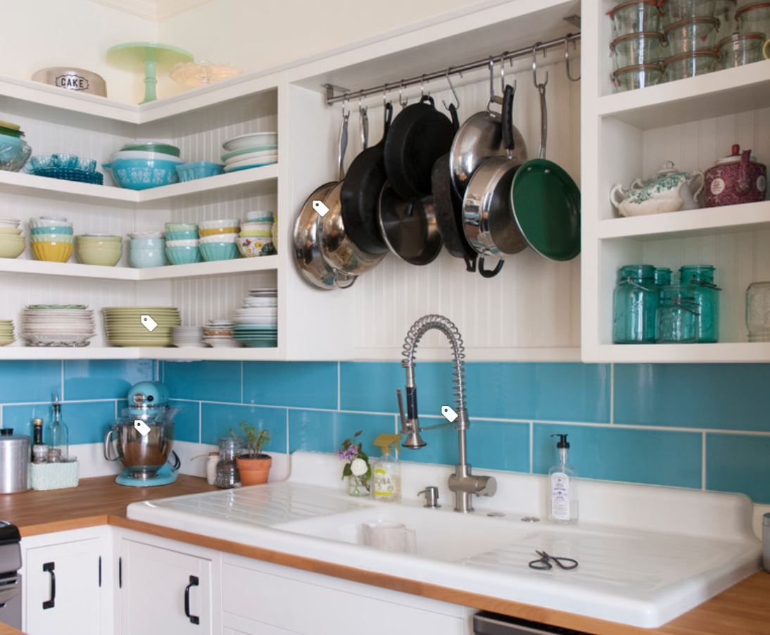 I love the idea of hanging pots and pans over the sink. Much better ...