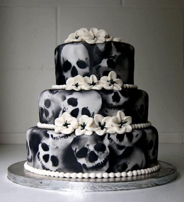"""Skull was sketched, and I made and cut my own stencils, then air brushed with black over a white fondant finish. (Obviously I am not the """"me"""" referred to in the previous description of how this cake was made. I don't have that much cakey-bakey talent!)"""