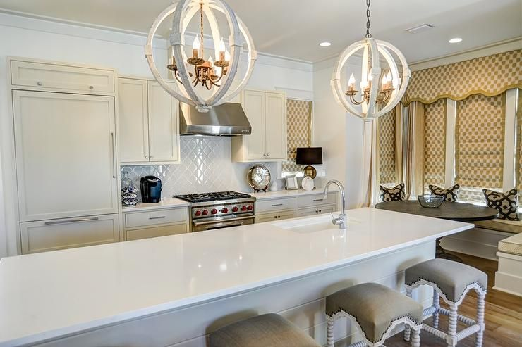 Well Designed Cottage Kitchen Features White Abacus Counter Sphere Lights Stools Accented With Gray Linen Upholster White Shiplap Kitchen Models Kitchen Design