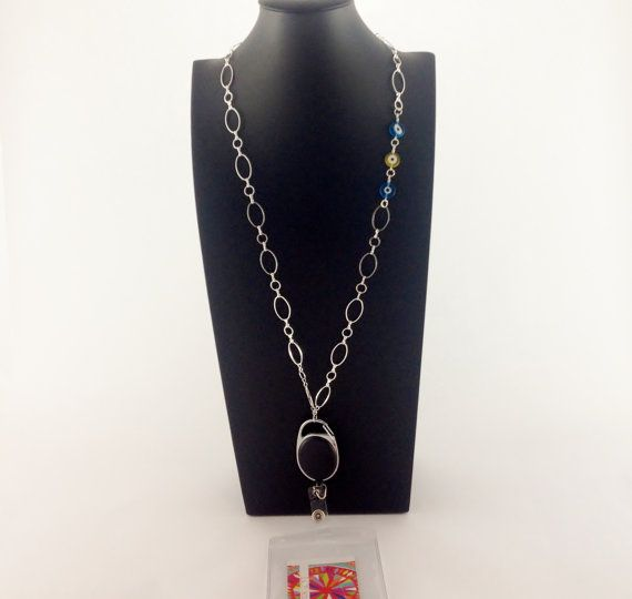 Did you know that the Eye Bead is believed to have the power to reflect (absorb or ward off) negative thinking or energy and thereby protects the person from the possibility of misfortune? Chic-at-work ID Badge Holder Necklace Fancy lanyard  by LOLAccents. $25