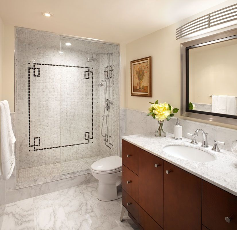 White Marble Bathroom With Black Accent Tile And Cherry
