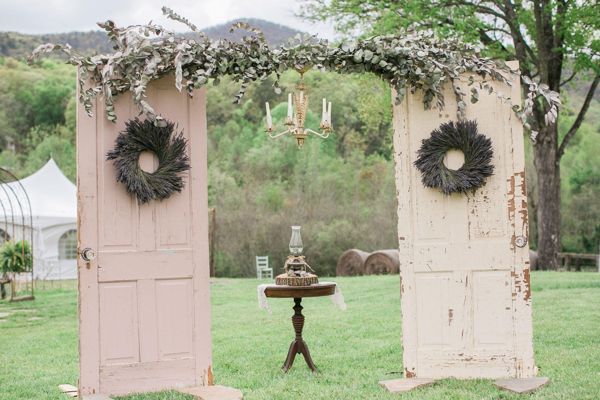 Erica's dad constructed a vintage door ceremony arch