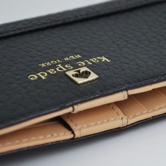 Kate Spade Southport Avenue Stacy Brand new Southport Ave Stacy slim wallet from Kate Spade in rich black pebbled cowhide with woven bookstripe lining. Features 14-karat light gold plated hardware. Snap closure. 12 credit card slots, one id slot and two bifolds. Measures 3.5''h x 6.6''w x 0.5''d.  Sealed in plastic direct from Kate Spade. style # wlru1394. kate spade Bags Wallets