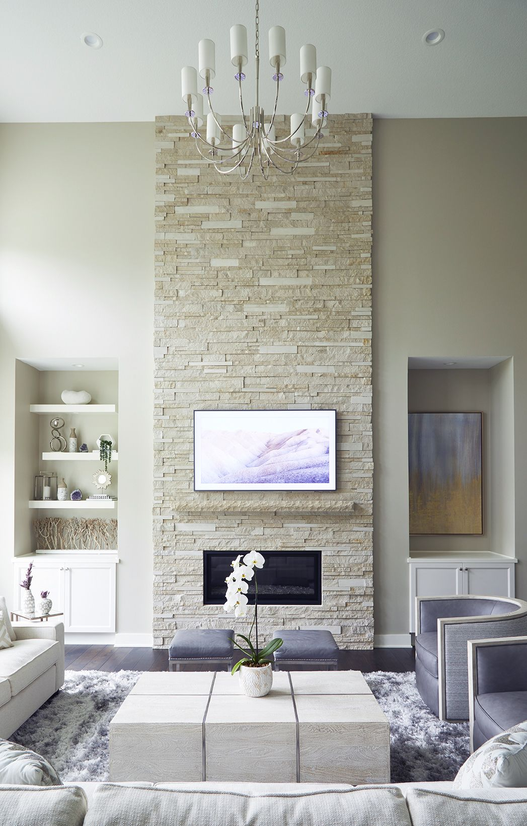Transitional Living Room Design With Stacked Stone Fireplace And Dark Hickory Floors By Jillian Lare Interior Des Moines Iowa