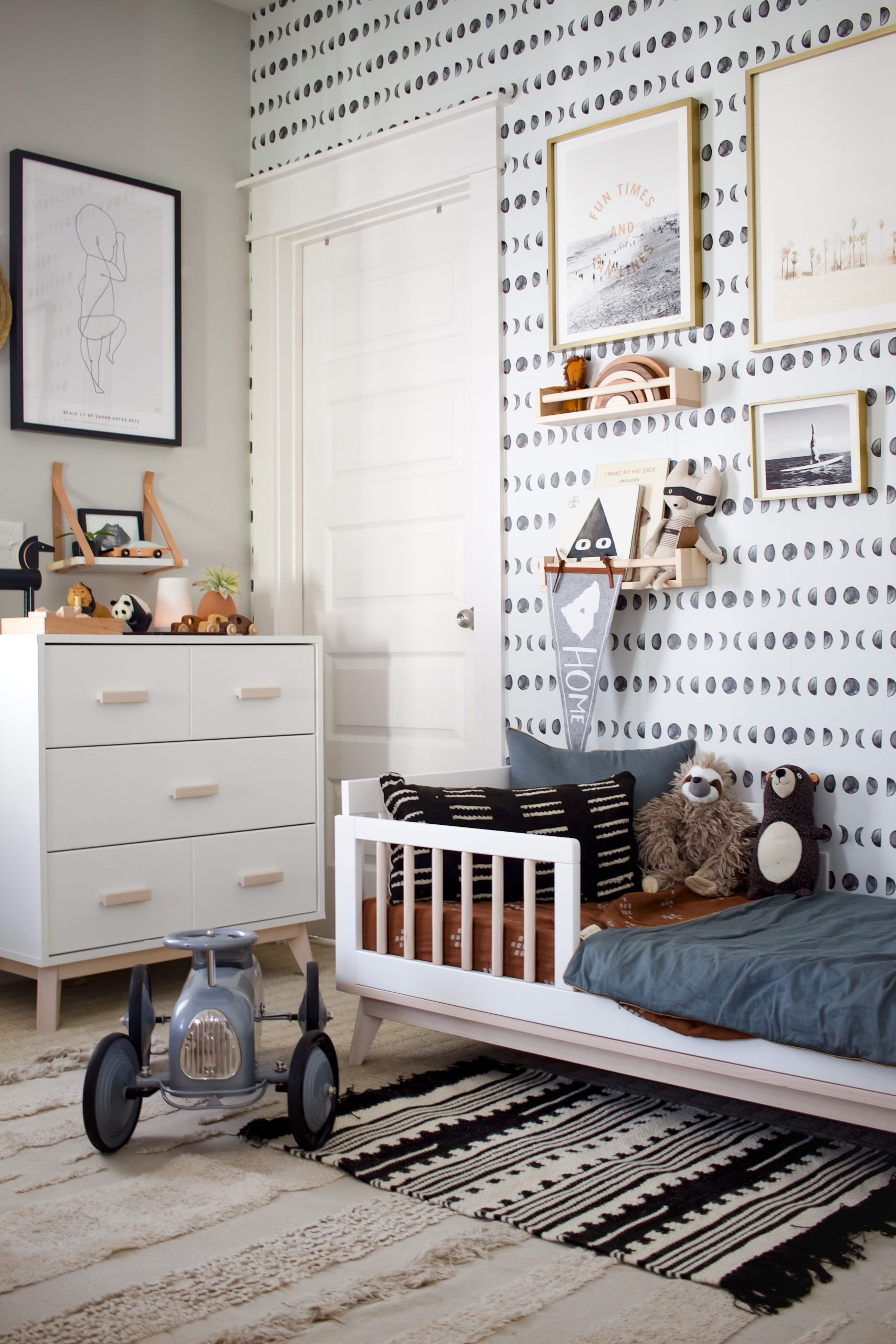 Toddler Boy Room with Graphic Wallpaper and Washable Rug