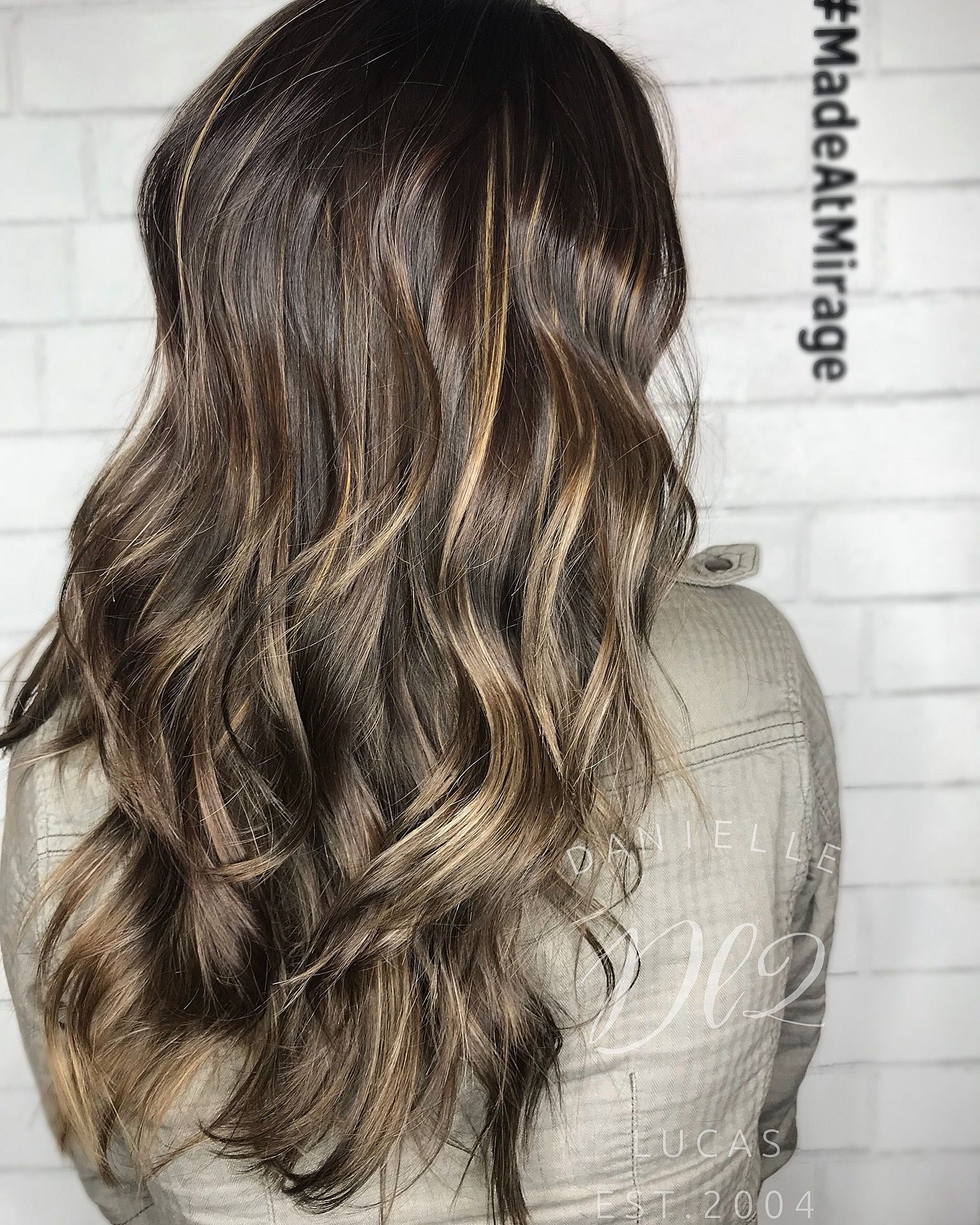 Reverse balayage From blonde back to brunette Hair by