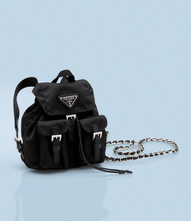 682a67f5a ... promo code for 550 vela fabric mini backpack detachable strap polished  steel hardware enameled triangle logo
