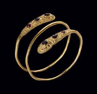 An Eastern Roman or Sarmatian gold, garnet and glass bracelet. circa late 1st-2nd century A.D. Photo: Christie's Images Ltd. 2010