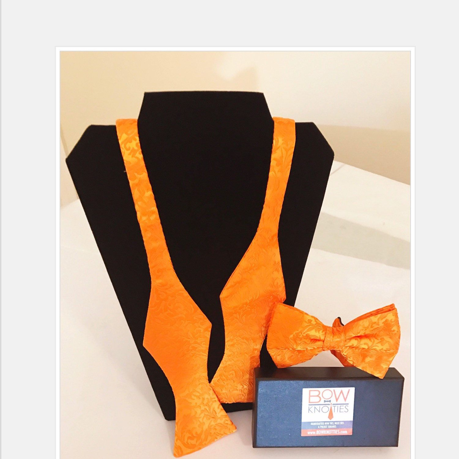 Orange Paisley Bow Tie. The option is yours pre-tied or self Tie.