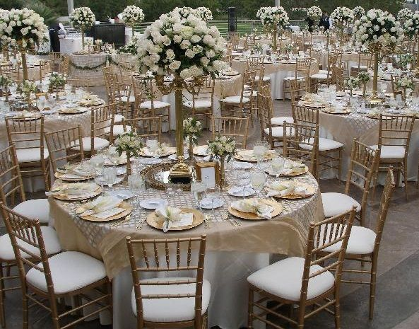 A Linen Tablecloth In Beige And Adding In White For A Wedding