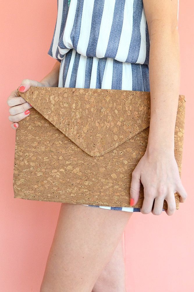 Make a statement in this oversized envelope clutch by Golden Stella. This soft…