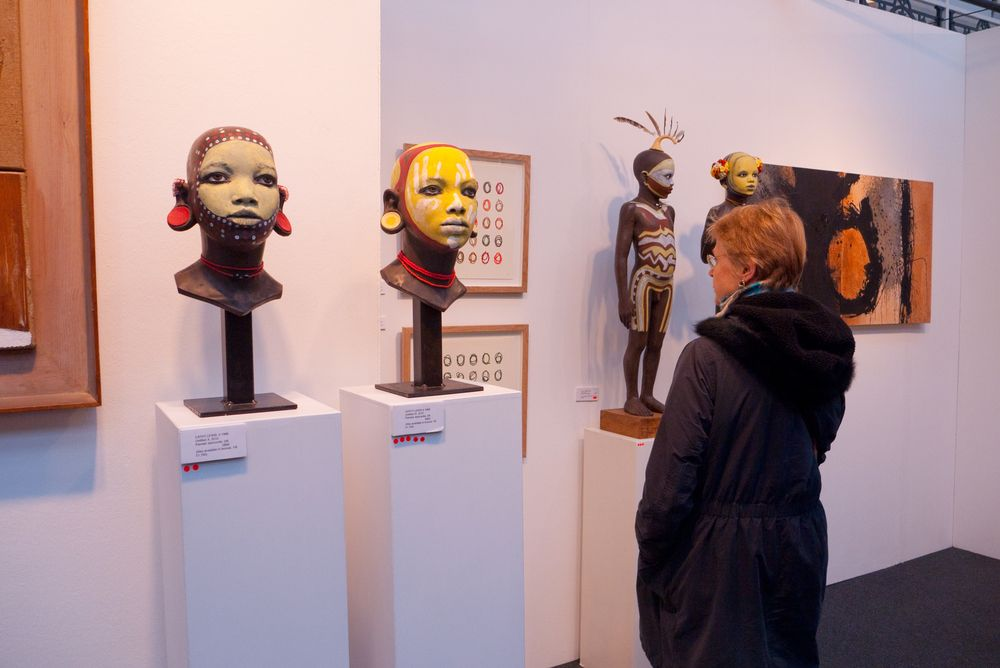 A visitor to the prestigious London Art Fair showing contemporary and modern art, looking at sculpture by artist Cathy Lewis. January 23, 2011 in London, UK.