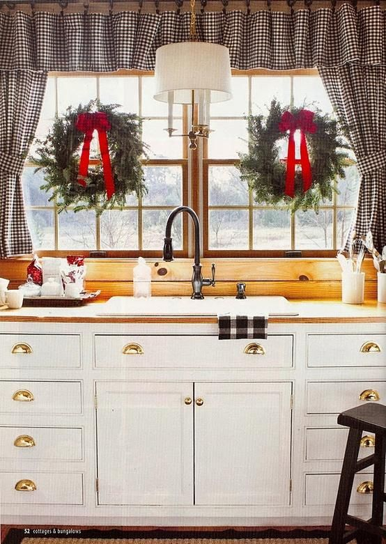 A kitchen window at Christmastime.