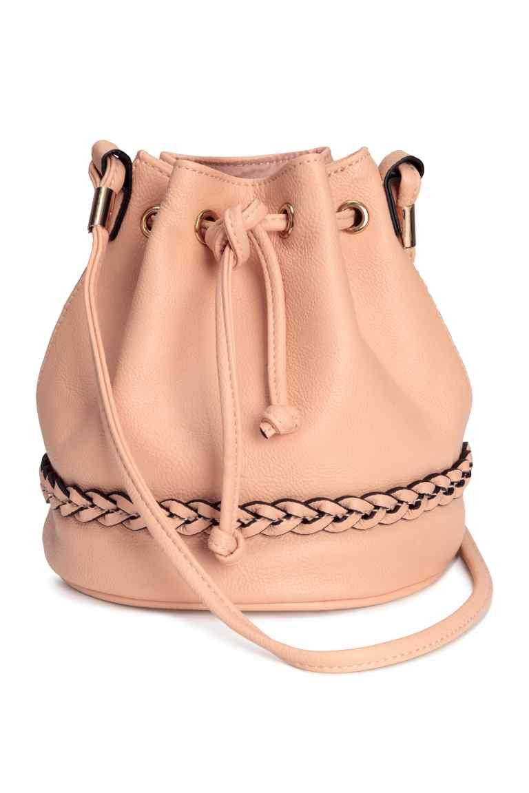 b7bdde45e8f6 Small bucket bag  Small bucket bag in grained imitation leather with a  braided trim at the bottom