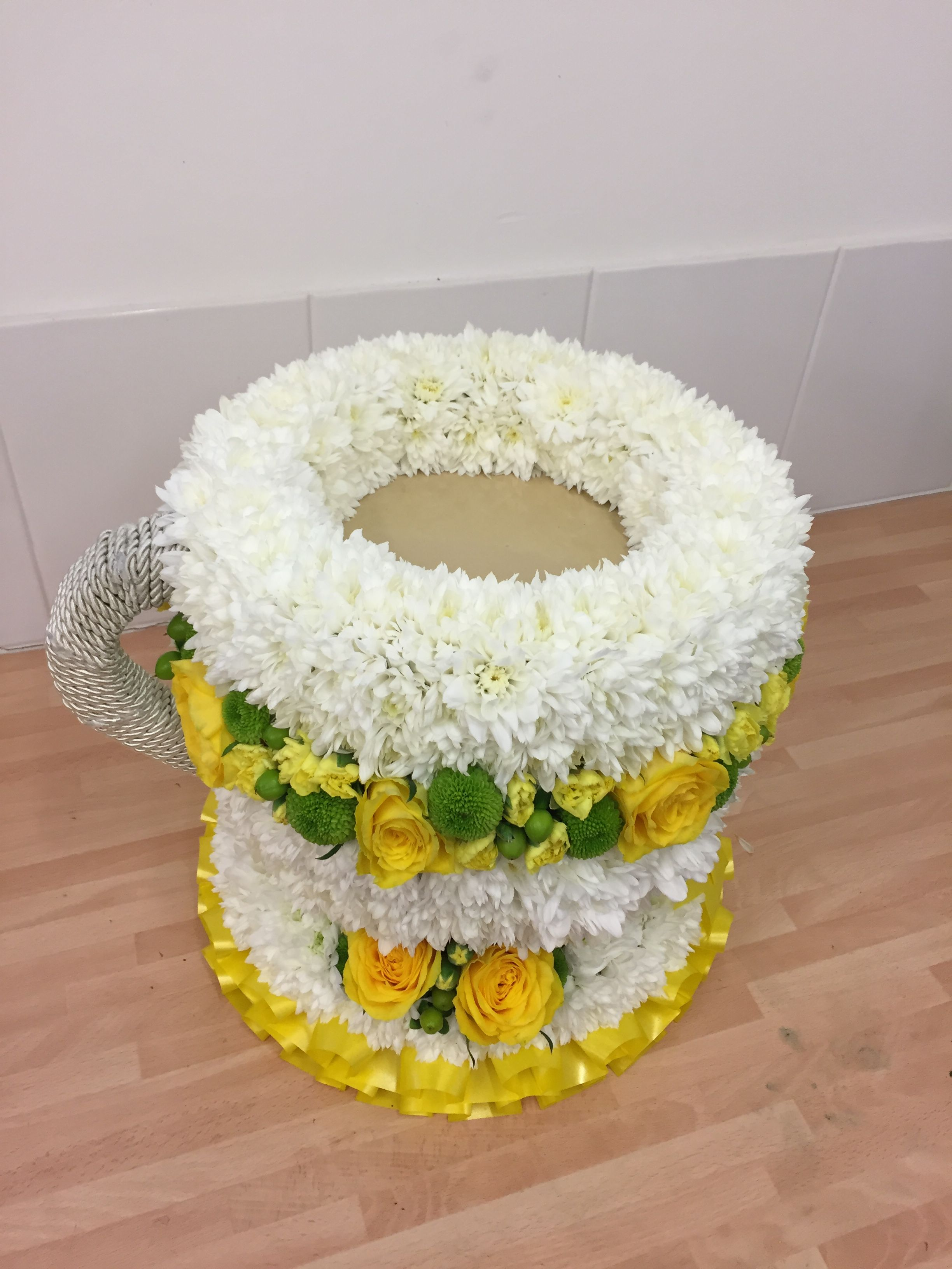 Cup of tea teacup yellow and white funeral tribute a pretty cup of tea teacup yellow and white funeral tribute a pretty alternative to traditional sympathy wreath flowers izmirmasajfo