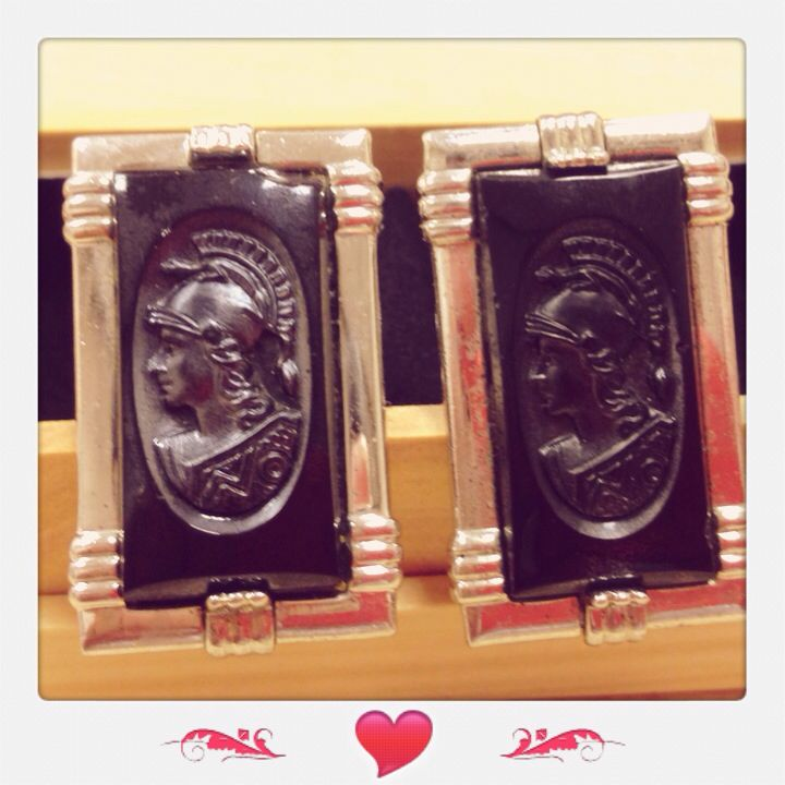 A pair of vintage large black and silver tone cameo intaglio cufflinks by SWANK.  Priced at $218.