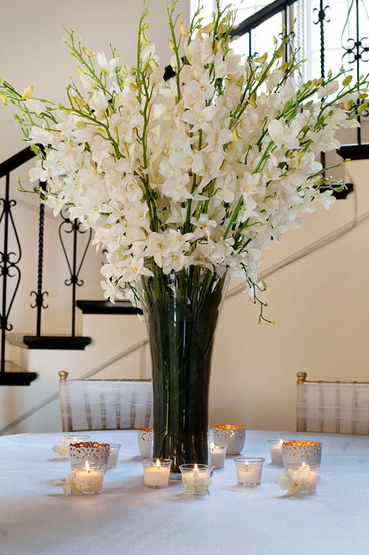 Centerpiece with trumpet shaped vase and styles of