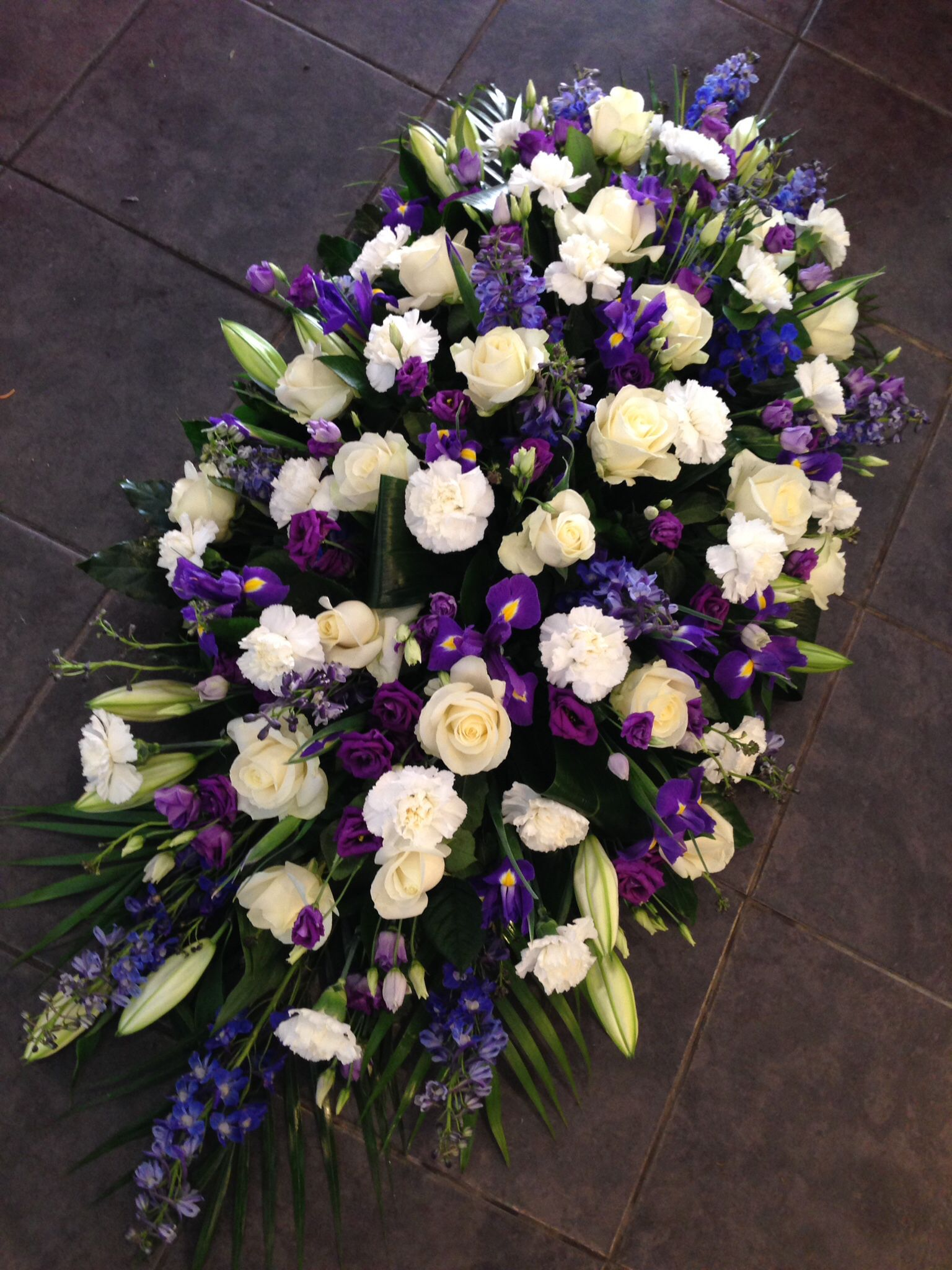 Blue and white casket spray floral pinterest casket sprays 21 funeral flowers from interflora blue and white casket spray izmirmasajfo Images
