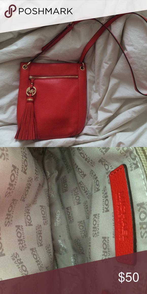 Michael Kors Crossbody Bag Super cute coral/red crossbody satchel with gold hardwear. In perfect condition. Michael Kors Bags Crossbody Bags