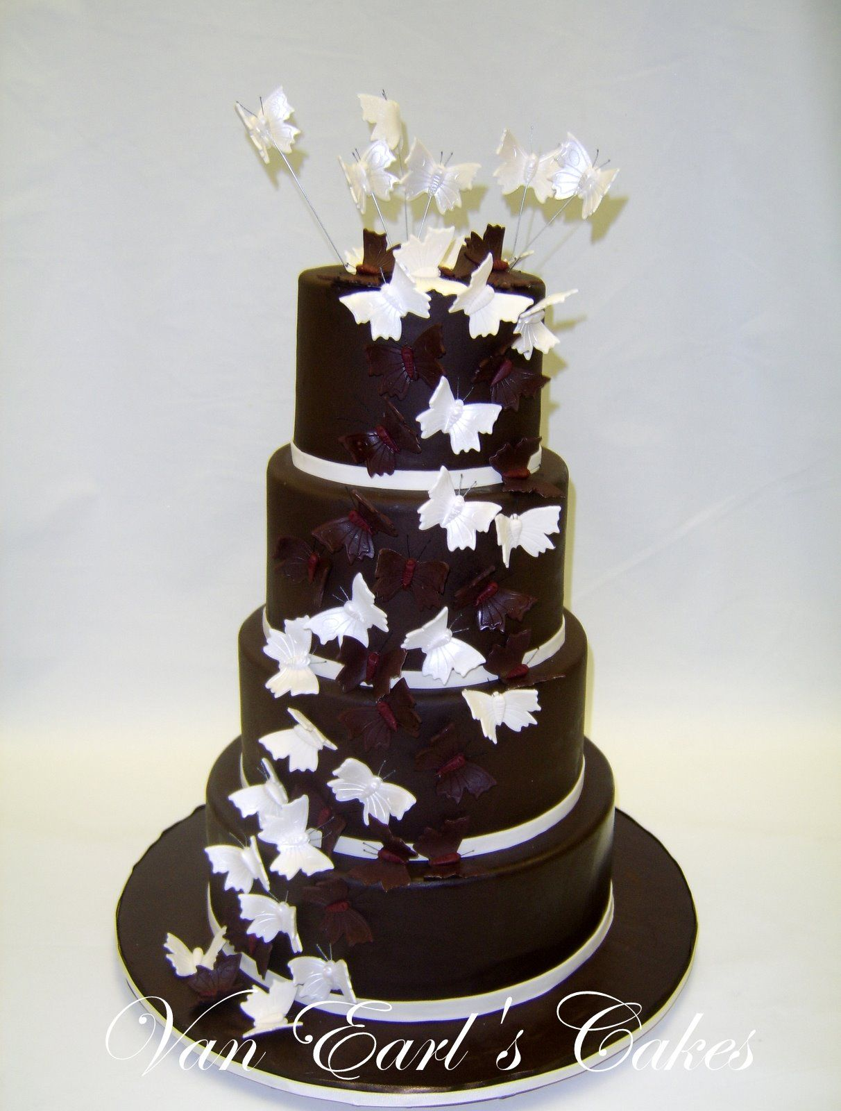 black cake with white butterflies by Van Earl\'s Cakes | A torturi ...