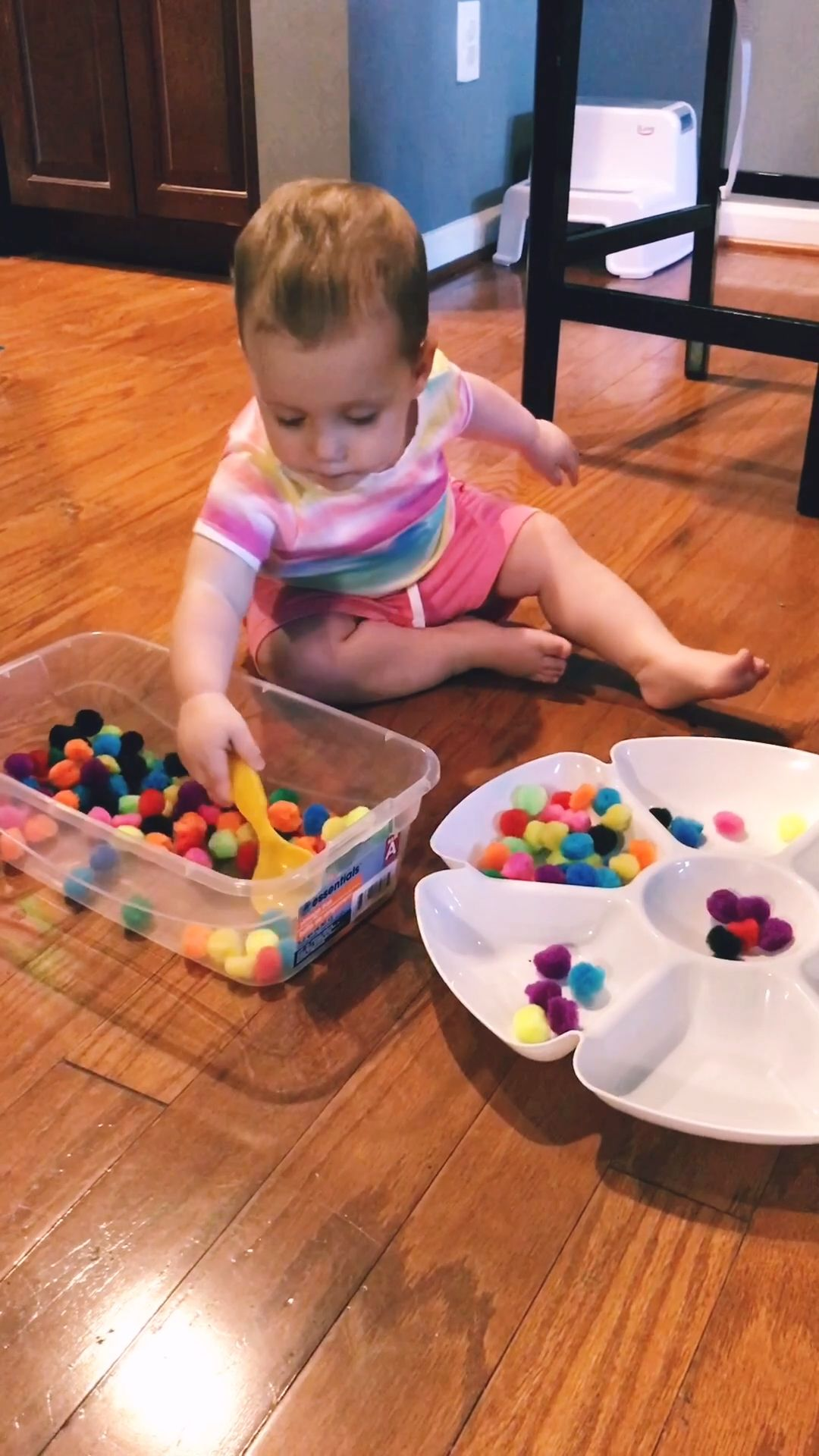 POMPOM SCOOP  TRANSFER COLOR SORT Easy sensory bin idea for toddlers  Scoop transfer and sort pompoms by color using this cute Dollar Tree serving tray Handeye coordinati...