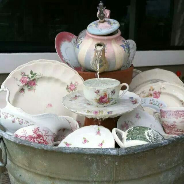 Dish Pan Table Top Water Fountain Cup Amp Saucer And The Teapot Are Setting Atop Flower