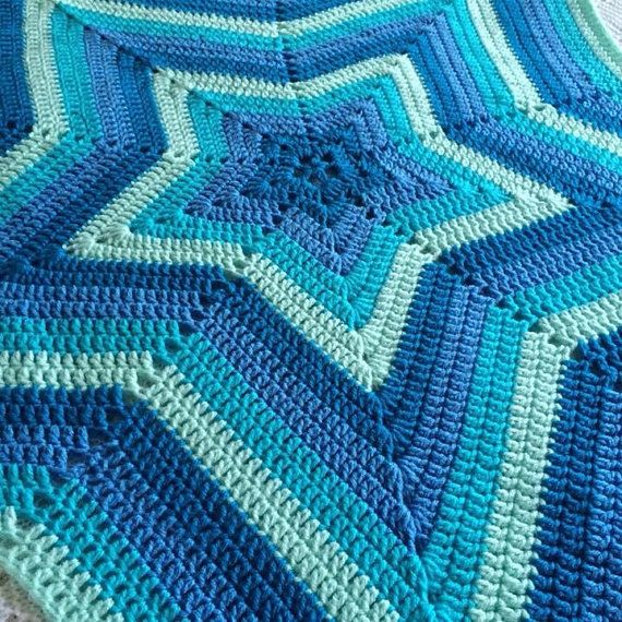 A Beautifully Bright And Vibrant Crochet Star Blanket In Varying