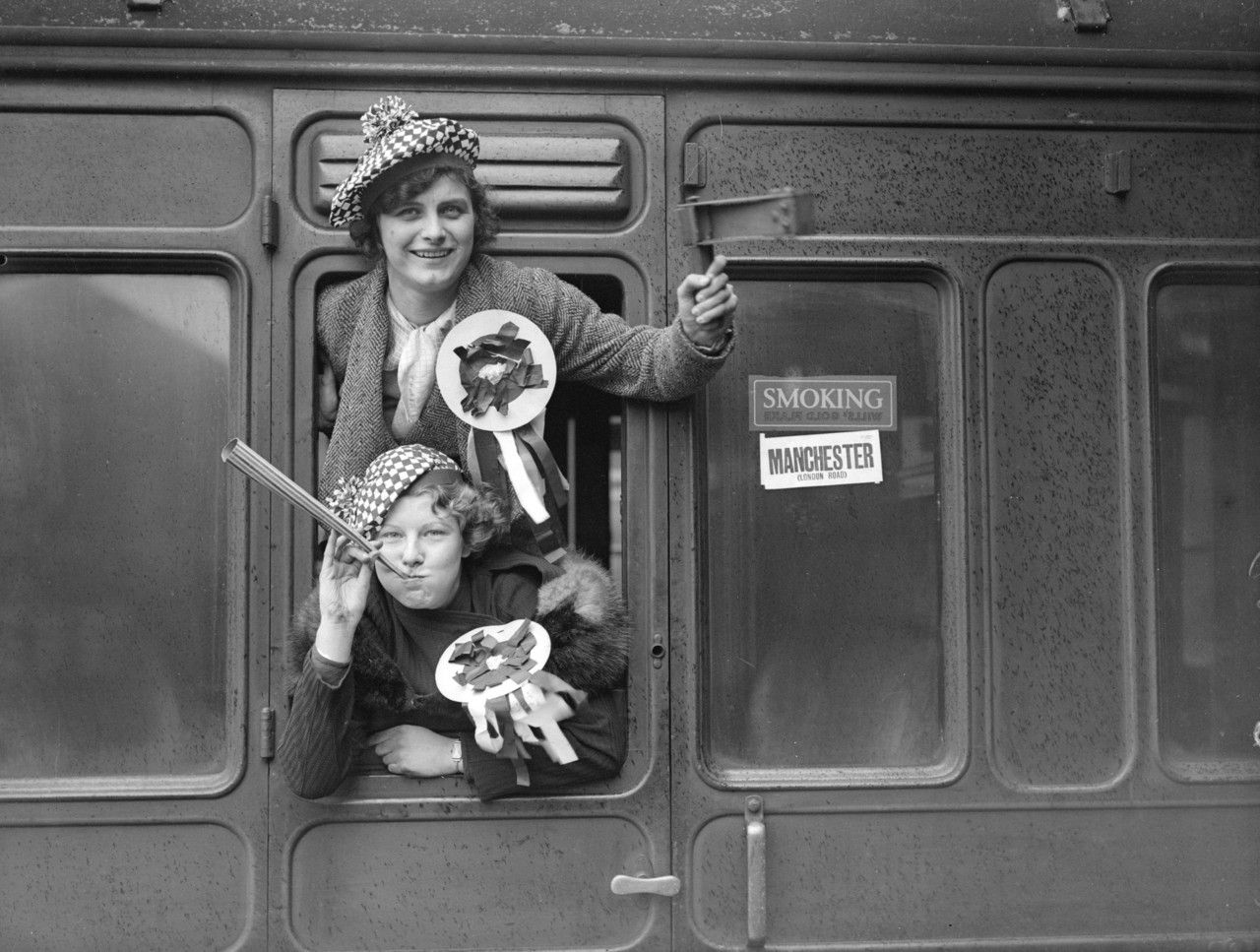 Manchester City FC fans with rattles and rosettes are in a train at Euston which is waiting to take them to White Hart Lane for a cup-tie match against Tottenham Hotspurs. (Photo by Reg Speller/Fox Photos/Getty Images). 12th January 1935 (The Hotspurs were my granda's fave team)
