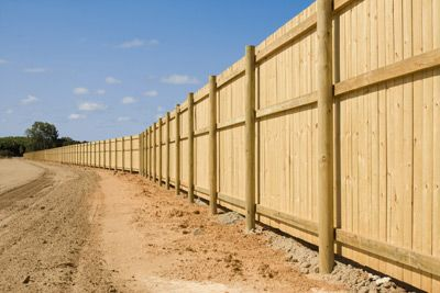 Rural Privacy fence with treated round post and three horizontal