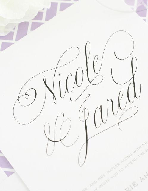 Wedding invitations with pretty script names and purple accents!