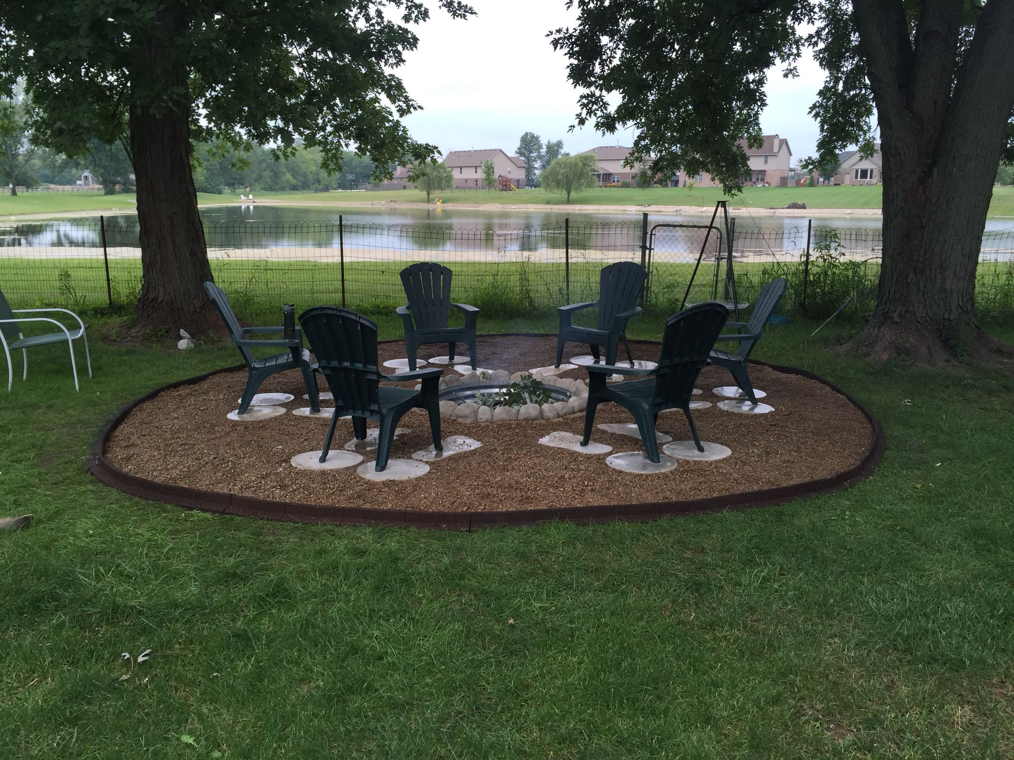 Great outdoor fire pit used galvanized ring concrete for Amazing outdoor fire pits