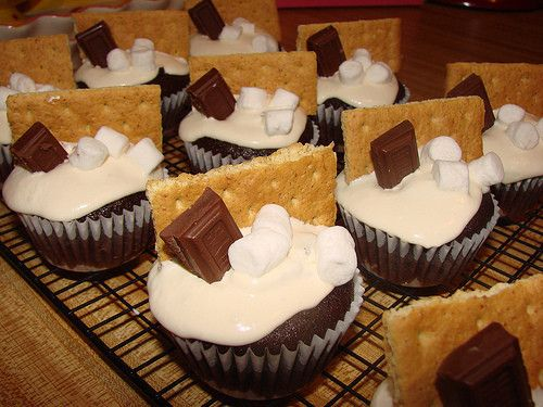Smore Cupcakes..bake any basic chocolate recipe for the cupcakes, frost with marshmallow fluff, then add graham squares, chocolate & marshmallows!