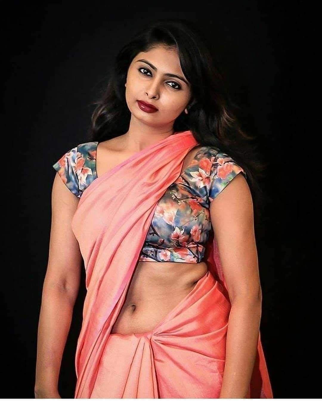 busty south aunty actress aksha red saree pallu drop big