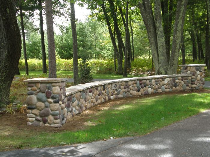 Like The Long Entry Wall Beneath The Trees Maybe A More Natural Looking Dry Stacked Wall Though Rock Wall Landscape Rock Retaining Wall Stone Walls Garden