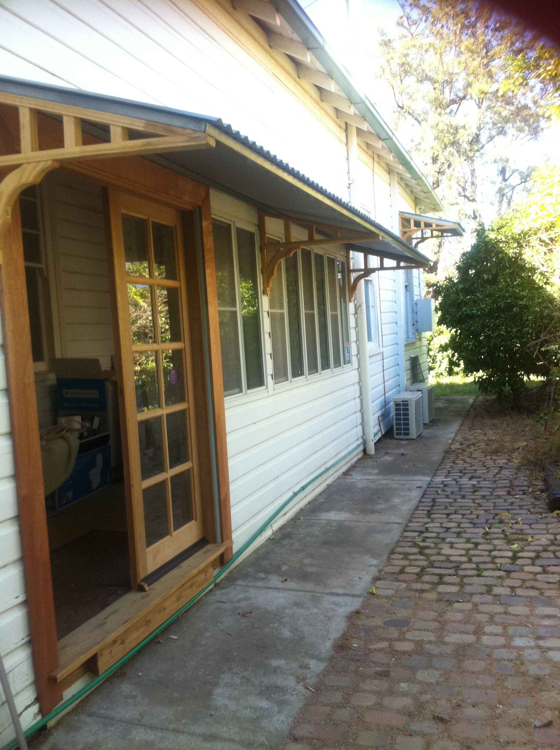 There we go new awning over new french doors and sun room home
