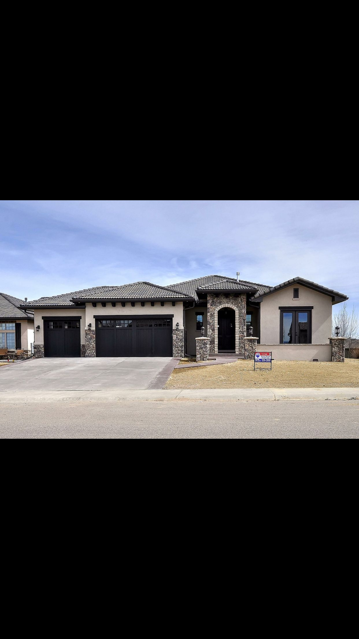 Ranch with black garage doors dream house in 2019 - Exterior paint coverage on stucco ...