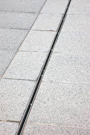 Pool deck slot drain