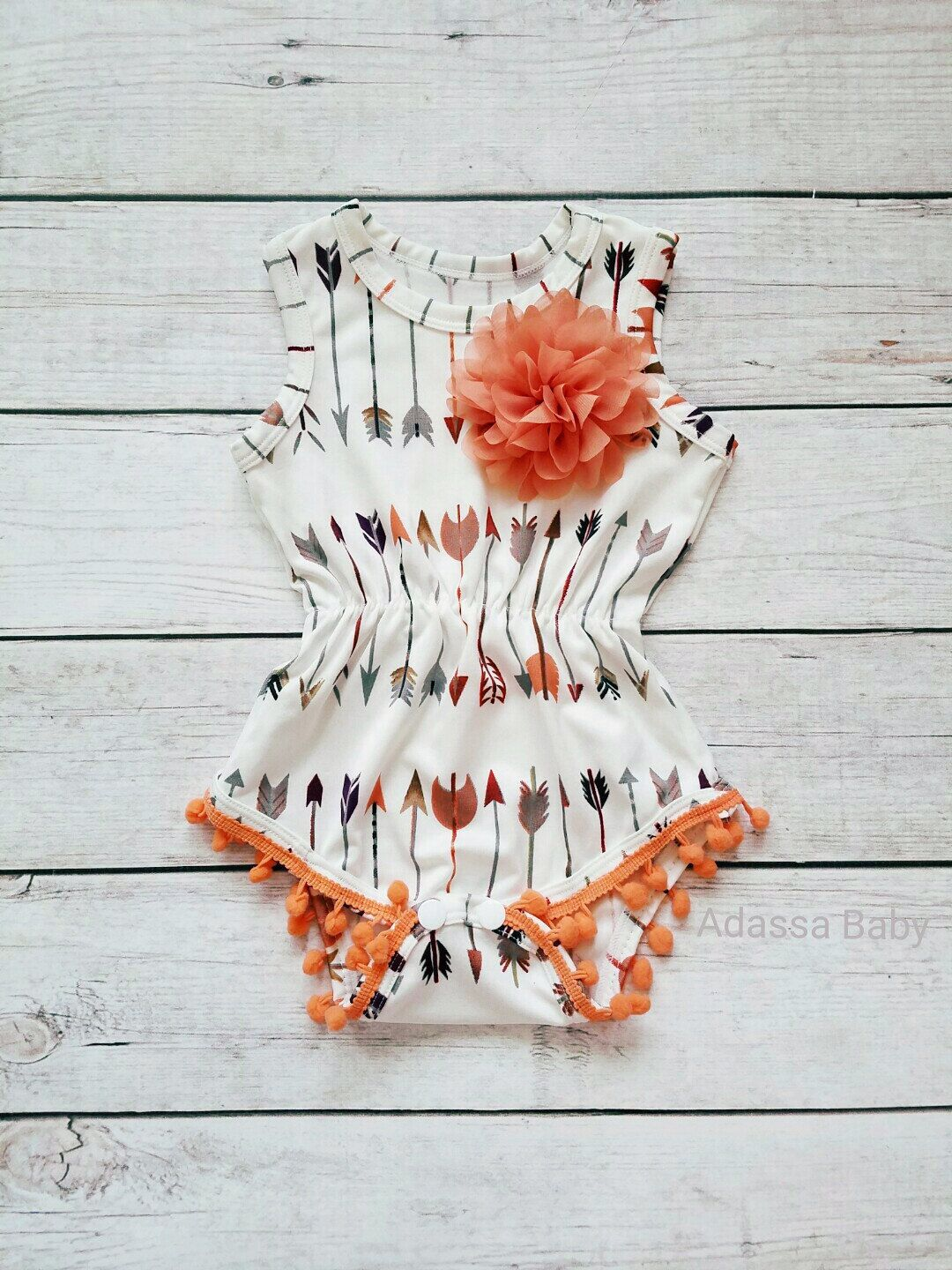 ae2b4bf03 Show your little princess off in this super cute peach and cream pom pom  romper embellished