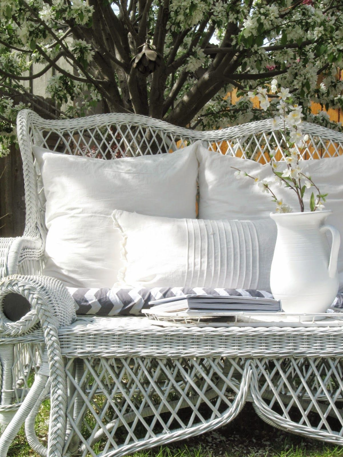 The Wicker House White Blossoms and Wicker