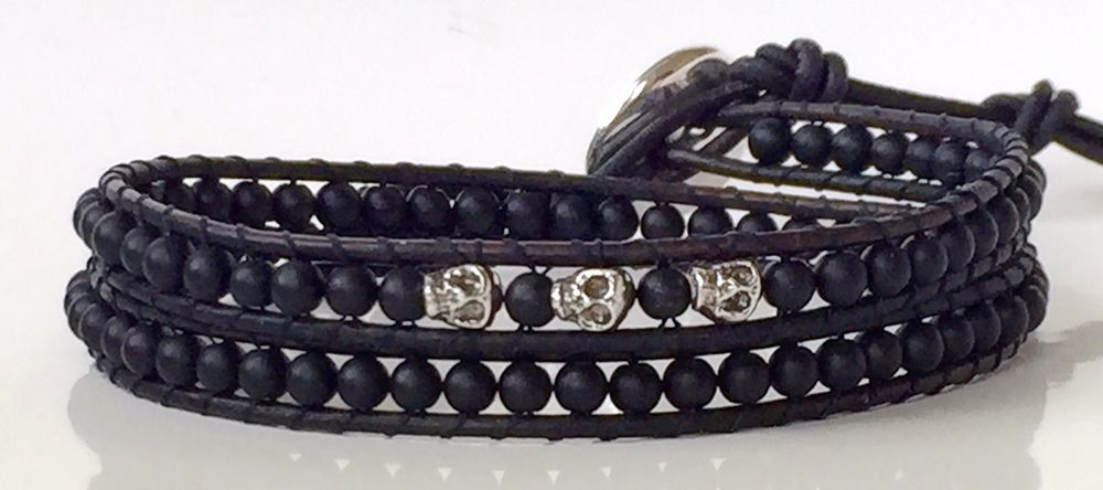 This Two Wrap has Matte Onyx Semi Precious Beads with Sterling Silver Skulls all hand woven onto Natural Black Leather. One wrap has the three Skulls and the other is plain.The beads are 3 to 3.5mm approx. and the Skulls are 4mm so Bracelet isn't bulky.The Bracelet measures 32.5 cm at the last bead extending too 35/37/39/41cm's with four button holes to adjust sizing with Stacks